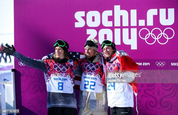 Silver medalist Staale Sandbech of Norway gold medalist Sage Kotsenburg of the United States and bronze medalist Mark McMorris of Canada celebrate...