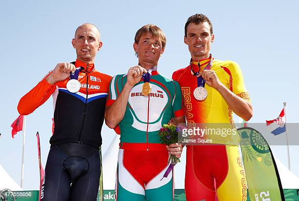 Silver medalist Stef Clement of Netherlands, gold medalist Vasil Kiryienka of Belarus and bronze medalist Luis Leon Sanchez Gil of Spain pose with...