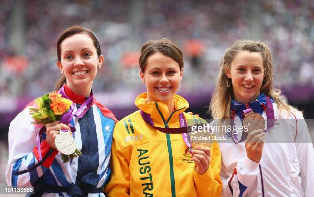 Silver medalist Stef Reid of Great Britain Gold medalist Kelly Cartwright of Australia and bronze medalist MarieAmelie Le Fur of France pose on the...