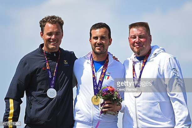 Silver medalist Stefan Nilsson of Sweden gold medalist Valerio Luchini of Italy and bronze medalist Marko Kemppainen of Finland pose with the medals...