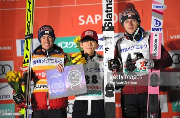 Silver medalist Stefen Kraft of Austria gold medalist Yukiya Sato of Japan and bronze medalist Dawid Kubacki of Poland pose during the medal ceremony...