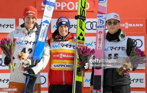 Silver medalist Stephen Leyhe of Germany gold medalist Stefen Kraft of Austria and bronze medalist Ryoyu Kobayashi of Japan pose during the medal...