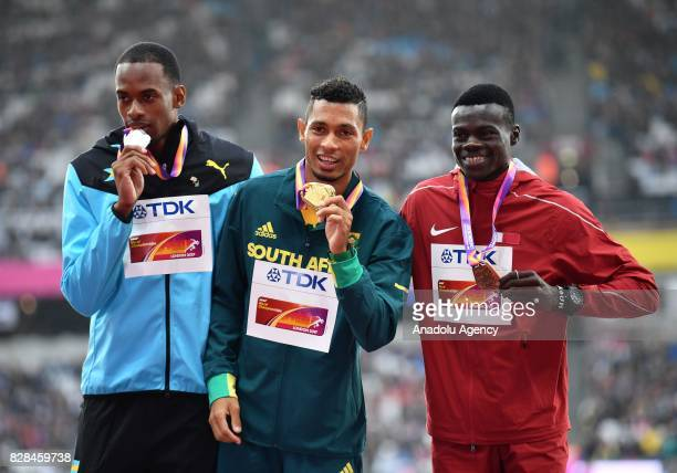 Silver medalist Steven Gardiner of the Bahamas gold medalist Wayde Van Niekerk of South Africa and bronze medalist Abdalelah Haroun of Qatar pose...
