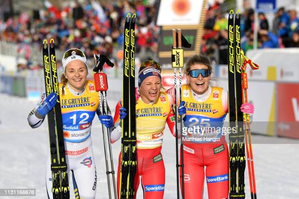 Silver medalist Stina Nilsson of Sweden gold medalist Maiken Caspersson Falla of Norway and Bronze medalist Mari Eide of Norway during the Women's...