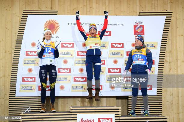 Silver medalist Stina Nilsson of Sweden gold medalist Maiken Caspersson Falla of Norway and Bronze medalist Mari Eide of Norway celebrate on the...