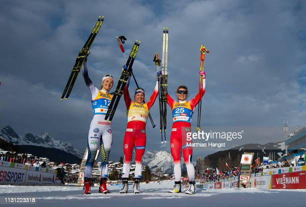 Silver medalist Stina Nilsson of Sweden gold medalist Maiken Caspersson Falla of Norway and Bronze medalist Mari Eide of Norway celebrate after the...