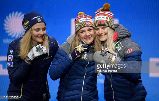Silver medalist Stina Nilsson of Sweden Gold medalist Maiken Caspersson Falla of Norway and Bronze medalist Mari Eide of Norway celebrate with their...