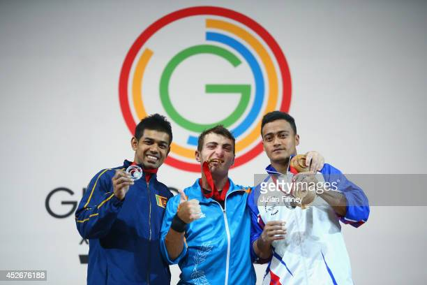 Silver medalist Sudesh Peiris of Sri Lanka Gold medalist Dimitris Minasidis of Cyprus bronze medalist Vaipava Ioane of Samoa pose during the medal...