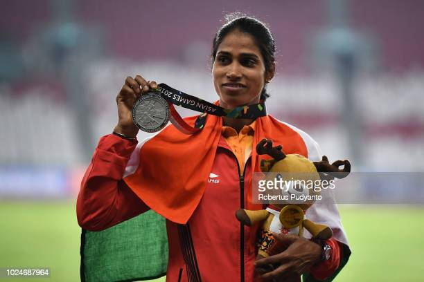 Silver medalist Sudha Singh of India celebrates on the podium during the victory ceremony of Women's 3000m Steeplechase on day nine of the Asian...