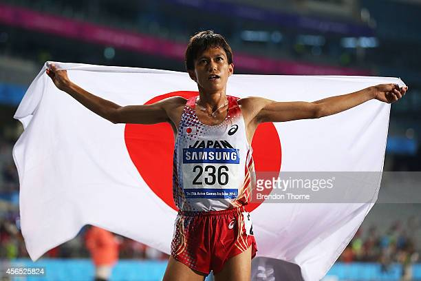 Silver medalist Suguru Osako celebrates following the Men's 10000m Final during day thirteen of the 2014 Asian Games at Incheon Asiad Main Stadium on...
