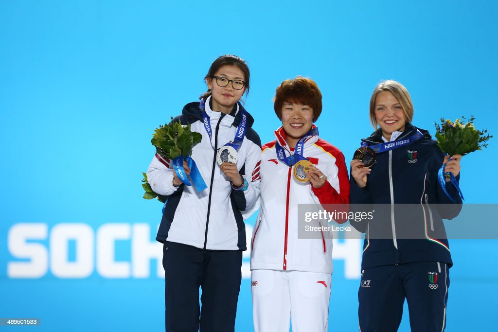 Silver medalist Suk Hee Shim of South Korea, gold medalist Yang Zhou of China and bronze medalist Arianna Fontana of Italy on the podium during the medal ceremony for the Short Track Speed Skating Women's 1500m on day 8 of the Sochi 2014 Winter Olympics at Medals Plaza on February 15, 2014 in Sochi, Russia.