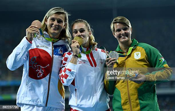 Silver medalist Sunette Viljoen of South Africa gold medalist Sara Kolak of Croatia and bronze medalist Barbora Spotakova of the Czech Republic pose...