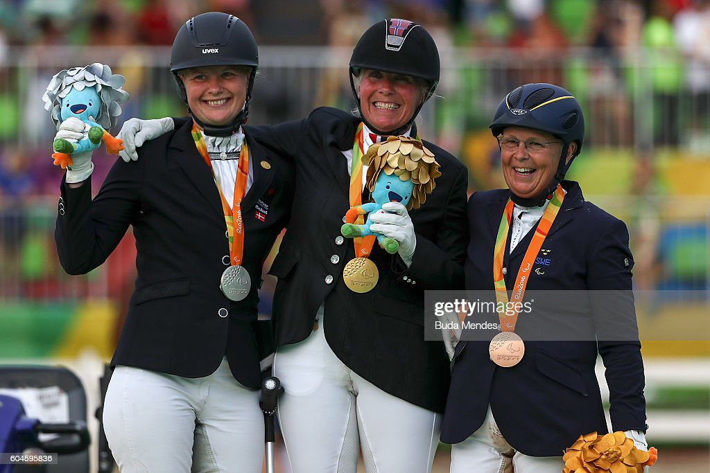 Silver medalist Susanne Sunesen, gold medalist Ann Cathrin Lubbe of Norway, bronze medalist Louise Etzner Jakobsson of Sweden celebrate on the podium at the medal ceremony for the Individual Championship Test -Grade III on day 6 of the Rio 2016 Paralympic Games at the Olympic Equestrian Centre on September 13, 2016 in Rio de Janeiro, Brazil.