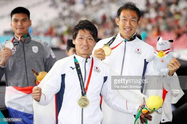 Silver medalist Suttisak Singkhon of Thailand, bronze medalist Akihiko Nakamura of Japan and gold medalist Keisuke Ushiro of Japan celebrate after...