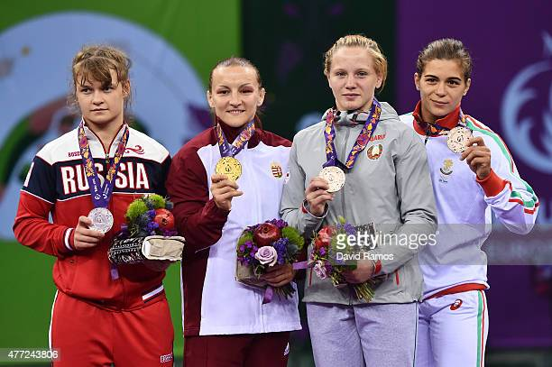 Silver medalist Svetlana Lipatova of Russia gold medalist Marianna Sastin of Hungary bronze medalist Veranika Ivanova of Belarus and bronze medalist...