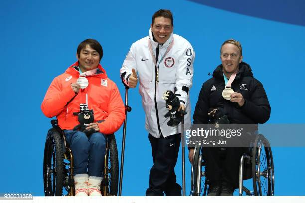 Silver medalist Taiki Morii of Japan Gold medalist Andrew Kurka of United States and bronze medalist Corey Peters of New Zealand pose for the medal...