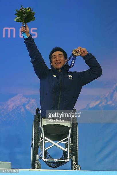 Silver medalist Takeshi Suzuki of Japan celebrates at the medal ceremony for the Men's Downhill Sitting during day one of Sochi 2014 Paralympic...