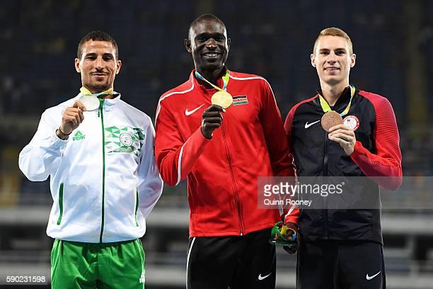 Silver medalist Taoufik Makhloufi of Algeria gold medalist David Lekuta Rudisha of Kenya and bronze medalist Clayton Murphy of the United States pose...