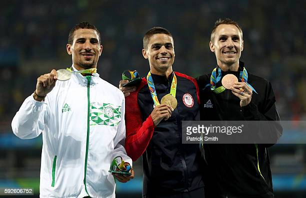 Silver medalist Taoufik Makhloufi of Algeria, gold medalist Matthew Centrowitz of the United States and bronze medalist Nicholas Willis of New...