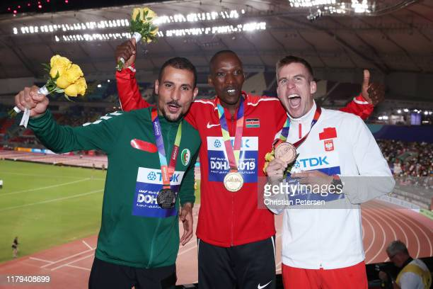 Silver medalist Taoufik Makhloufi of Algeria, gold medalist Timothy Cheruiyot of Kenya and bronze medalist Marcin Lewandowski of Poland stand on the...
