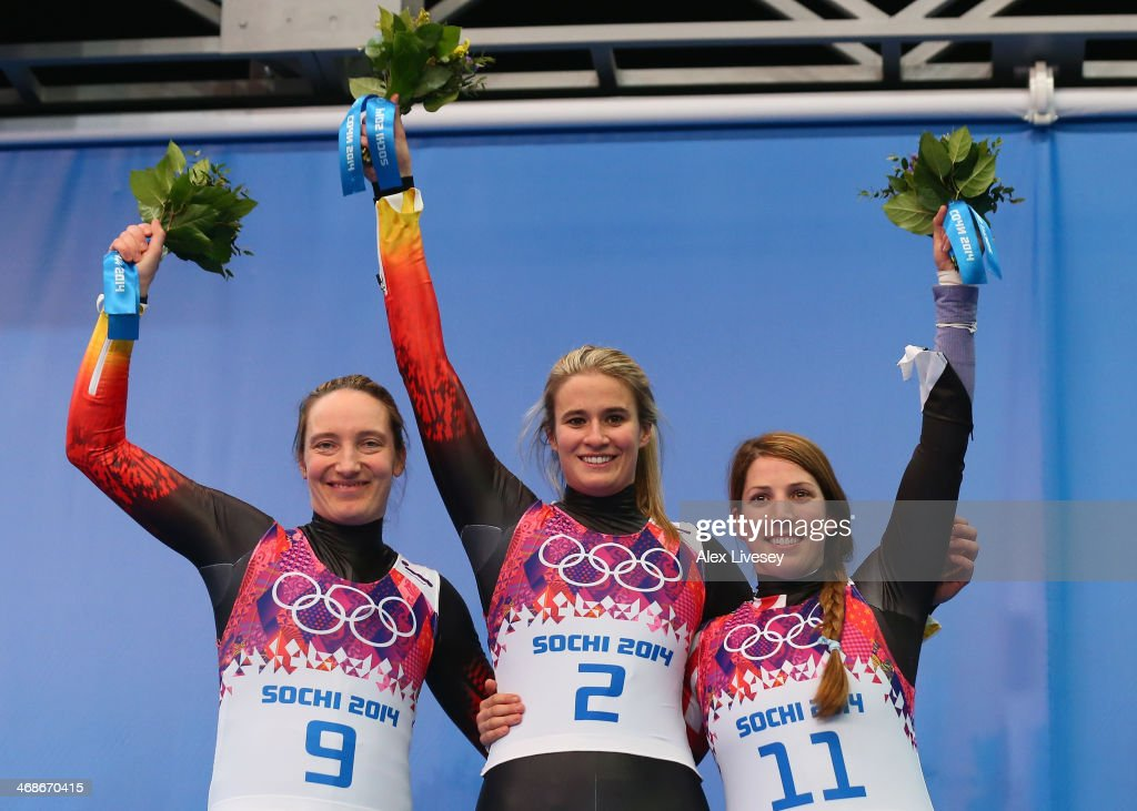 Silver medalist Tatjana Huefner of Germany, gold medalist Natalie Geisenberger of Germany and bronze medalist Erin Hamlin of the United States celebrate during the flower ceremony for the Women's Luge Singles on Day 4 of the Sochi 2014 Winter Olympics at Sliding Center Sanki on February 11, 2014 in Sochi, Russia.