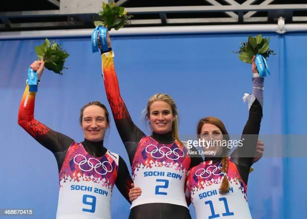 Silver medalist Tatjana Huefner of Germany gold medalist Natalie Geisenberger of Germany and bronze medalist Erin Hamlin of the United States...