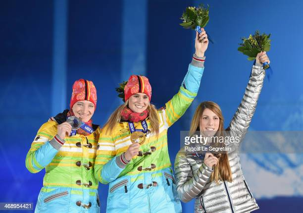 Silver medalist Tatjana Huefner of Germany gold medalist Natalie Geisenberger of Germany and bronze medalist Erin Hamlin of the United States...