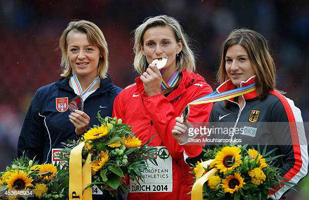 Silver medalist Tatjana Jelaca of Serbia gold medalist Barbora Spotakova of Czech Republic and bronze medalist Linda Stahl of Germany stand on the...