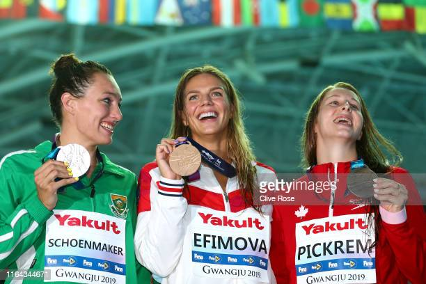 Silver medalist Tatjana Schoenmaker of South Africa gold medalist Yulia Efimova of Russia and bronze medalist Sydney Pickrem of Canada pose during...