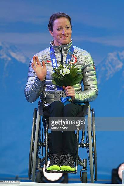 Silver medalist Tatyana McFadden of the United States celebrates on the podium during the medal ceremony for the women's 1km sprint, sitting...