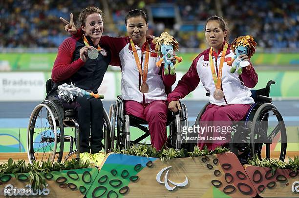 Silver medalist Tatyana McFadden of the United States gold medalist Wenjun Liu of China and bronze medalist Yingjie Li of China celebrate on the...