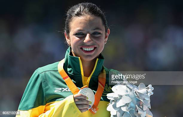 Silver medalist Taylor Doyle celebrate on the podium at the medal ceremony for the the Women's Long Jump T38 at Olympic Stadium during day 5 of the...