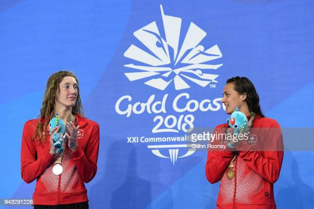 Silver medalist Taylor Ruck of Canada and gold medalist Kylie Masse of Canada look on during the medal ceremony for the Women's 200m Backstroke Final...