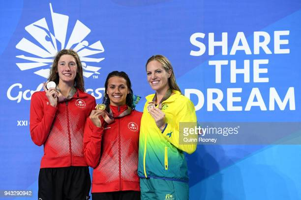 Silver medalist Taylor Ruck of Canada gold medalist Kylie Masse of Canada and bronze medalist Emily Seebohm of Australia pose during the medal...