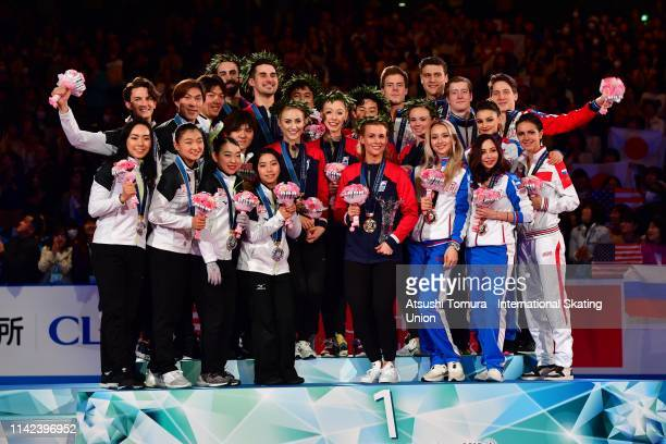 Silver medalist Team Japan gold medalist Team USA and bronze medalist Team Russia pose on the podium at the victory ceremony on day three of the ISU...