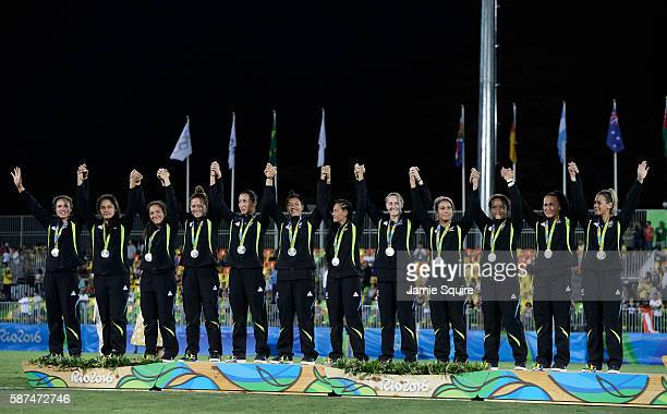 Silver medalist team New Zealand celebrate on the podium during the medal ceremony for the Women's Rugby Sevens on Day 3 of the Rio 2016 Olympic...