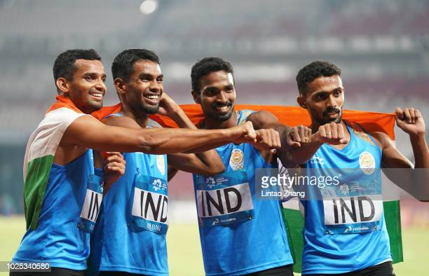 Silver medalist team of India celebrate during the medal ceremony for the Men's 4x400m relay on day twelve of the Asian Games on August 30 2018 in...