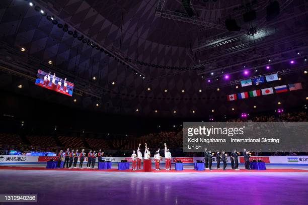 Silver medalist Team USA, gold medalist Team Russia and bronze medalist Team Japan are seen at the medal ceremony on day three of ISU World Team...