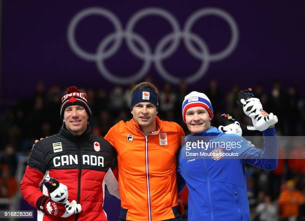 Silver medalist TedJan Bloemen of Canada gold medalist Sven Kramer of the Netherlands and bronze medalist Sverre Lunde Pedersen of Norway celebrate...