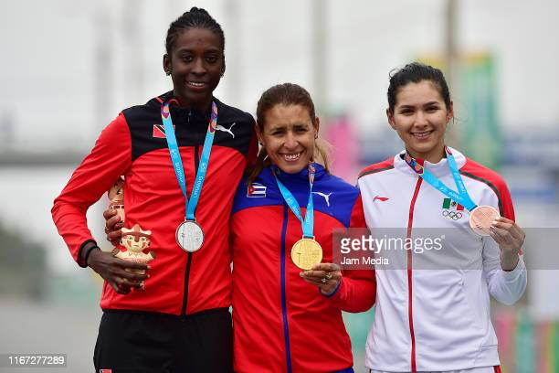 Silver medalist Teniel Campbell from Trinidad and Tobago, gold medalist Arlenis Sierra of Cuba and bronze medalist Lizbeth Salazar of Mexico pose...