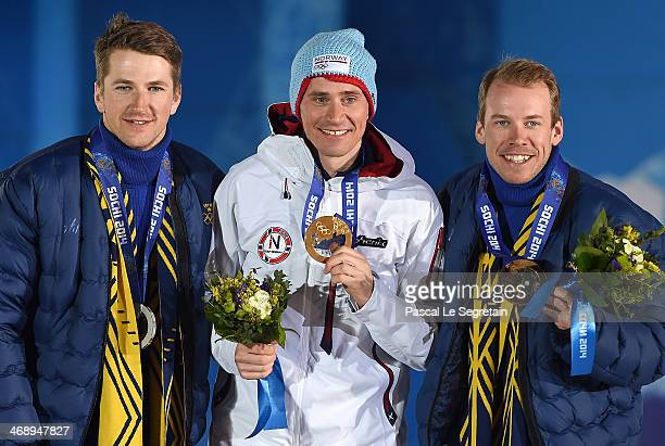 Silver medalist Teodor Peterson of Sweden gold medalist Ola Vigen Hattestad of Norway and bronze medalist Emil Joensson of Sweden celebrate on the...
