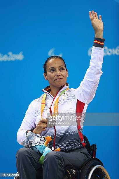 Silver medalist Teresa Perales of Spain celebrates on the podium at the medal ceremony for the Women's 100m Freestyle S5 on day 10 of the Rio 2016...