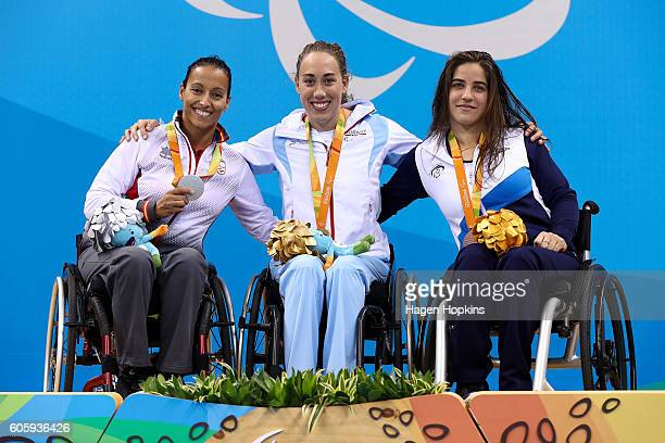 Silver medalist Teresa Perales of Spain gold medalist Sarah Louise Rung of Norway and bronze medalist Inbal Pezaro of Israel celebrate on the podium...