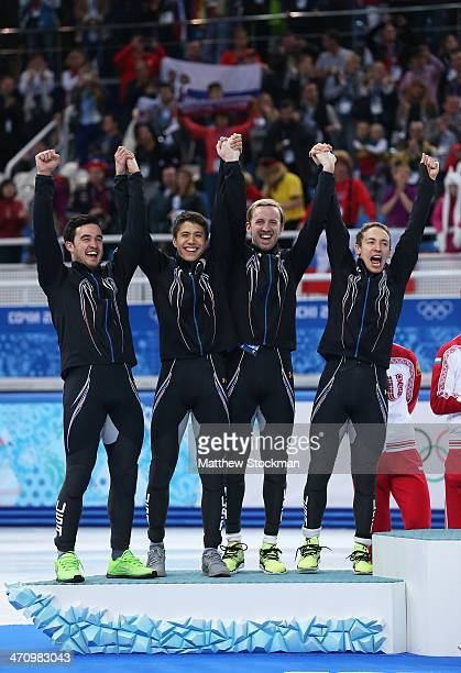 Silver medalist the United States celebrate on the podium during the flower ceremony for the Men's 5000m Relay on day fourteen of the 2014 Sochi...