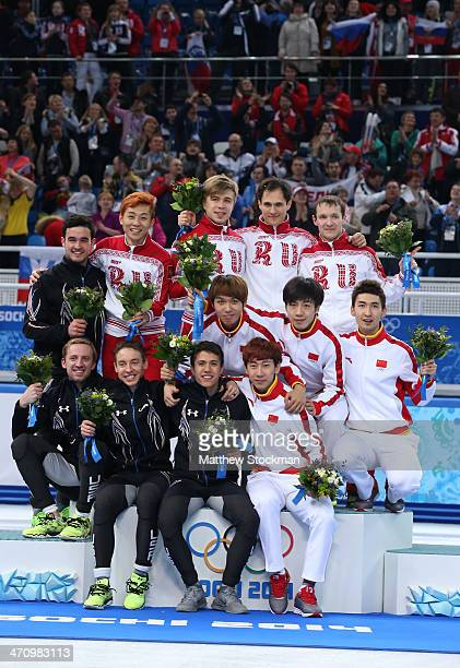 Silver medalist the United States gold medalists Russia and bronze medalist China celebrate on the podium during the flower ceremony for the Men's...