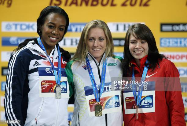 Silver medalist Tiffany Porter of Great Britain gold medalist Sally Pearson of Australia and bronze medalist Alina Talay of Belarus stand on the...
