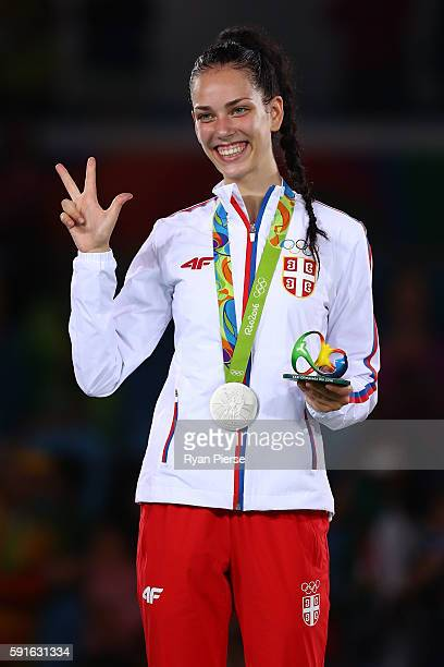 Silver medalist Tijana Bogdanovic of Serbia stands on the podium during the medal ceremony for the Taekwondo Women's 49kg contest during Day 12 of...
