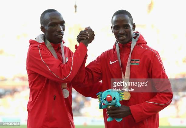 Silver medalist Timothy Cheruiyot of Kenya and gold medalist Elijah Motonei Manangoi of Kenya celebrate during the medal ceremony for the Men's 1500...