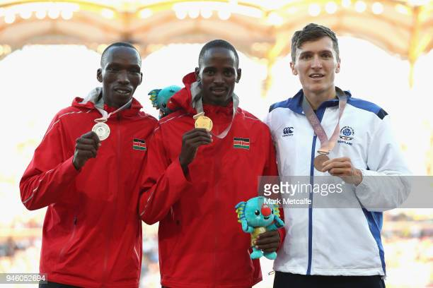 Silver medalist Timothy Cheruiyot of Kenya, gold medalist Elijah Motonei Manangoi of Kenya and bronze medalist Jake Wightman of Scotland pose during...
