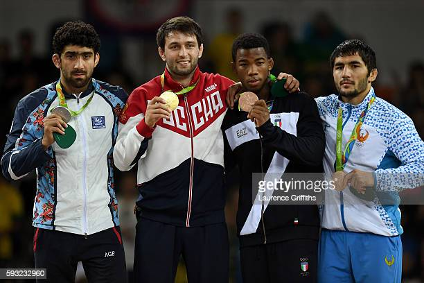 Silver medalist Toghrul Asgarov of Azerbaijan, gold medalist Soslan Ramonov of Russia, bronze medalist Frank Chamizo Marquez of Italy and bronze...